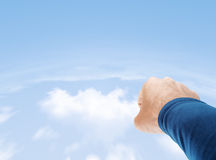 Superman Flying. Superman hand flying in cloudy sky with copy space Royalty Free Stock Images