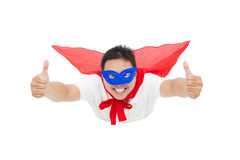 Superman flying and thumb up with red cape Royalty Free Stock Photography