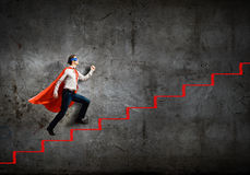 Superman on ladder Royalty Free Stock Image