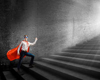 Superman on ladder Royalty Free Stock Photos