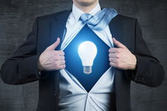 Superman and light bulb Royalty Free Stock Photos