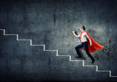 Superman na escada foto de stock royalty free