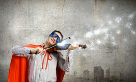Superman playing violin Stock Photography