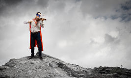 Superman playing violin Royalty Free Stock Photo