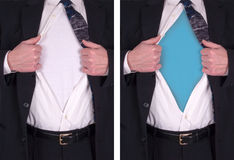 Superman, Superhero Concept, Blank Shirt. Clark Kent concept for turning into Superman or a superhero with super powers. Man or male wears a suit and tie and Royalty Free Stock Photography