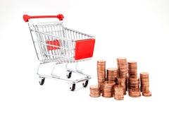 Supermarché de voiture avec des pièces de monnaie Image stock