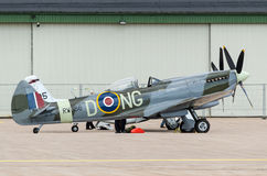 Supermarine Spitfire airborne near the hangar Stock Photography