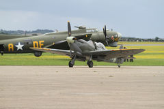 Supermarine Spitfire and Boeing B17 together on the runway at Duxford aerodrome. Supermarine Spitfire 2 seater and Boeing B17 together on the runway at Duxford royalty free stock image