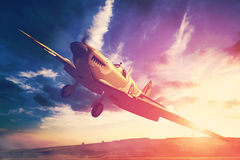 Supermarine Spitfire in fligjt with clouds during sunset. Render of a ww2 Supermarine Spitfire 3D model in flight Royalty Free Stock Photography