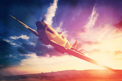Supermarine Spitfire in fligjt with clouds during sunset Stock Photography