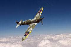 Supermarine Spitfire. Render of a ww2 Supermarine Spitfire 3D model in flight Royalty Free Stock Images