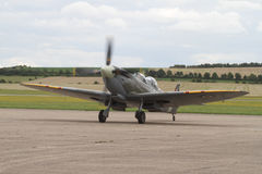 Supermarine Spitfire 2 seater front three quarter view - taxing on runway at Duxford aerodrome. Supermarine Spitfire 2 seater front three quarter view - taxiing stock image