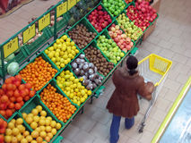 Supermarket. Buyer chooses fruits in the supermarket Stock Photography