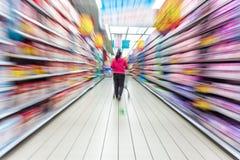 Supermarket aisle,motion blur Royalty Free Stock Photos