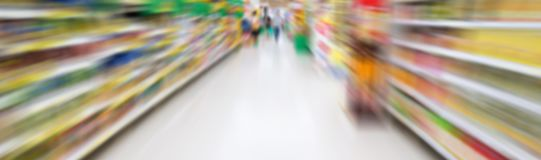 Supermarket aisle with motion blur Stock Photos