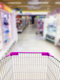 Supermarket Aisle and Shelves in blurry Royalty Free Stock Image