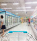 Supermarket Aisle and Shelves in blurry Stock Images