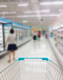 Supermarket Aisle and Shelves in blurry Stock Photo