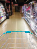 Supermarket Aisle and Shelves in blurry Royalty Free Stock Images
