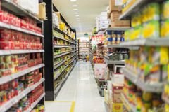 Supermarket Aisle. And shelves displaying variety of groceries product Royalty Free Stock Photo