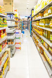 Supermarket Aisle. And shelves displaying variety of groceries product along the cooking oil department royalty free stock photography