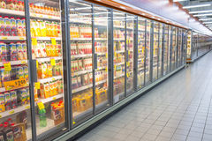 Supermarket Aisle. Stretch of shelf fridge with glass door selling variety of juice and other beverage at the supermarket aisle. Photo was taken on 21 September stock photo