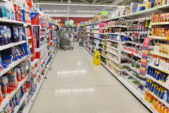 Supermarket Aisle View. London, UK - August 18, 2014: An aisle is seen in an Asda supermarket. Walmart owned Asda is the UK`s second largest retail chain after Royalty Free Stock Photos