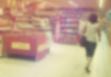 Supermarket Aisles out of Focus Royalty Free Stock Image