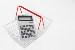 Supermarket basket and calculator Stock Photos