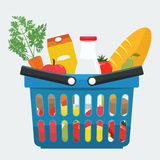 Supermarket basket full of fresh products, bread, vegetables. Stock Image
