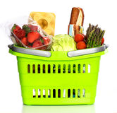 Supermarket basket full with grocery products Royalty Free Stock Images