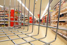 Supermarket basket view. Photo of supermarket store with view from inside customers basket or trolley Stock Image