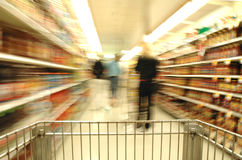 Supermarket Blur. With Shoppers Stock Photo