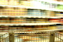 Supermarket Blur Cans. Motion blur of canned good on supermarket shelves Royalty Free Stock Image
