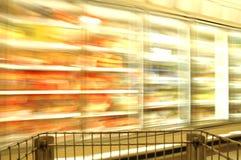 Supermarket Blur Frozen. Motion blur of supermarket basket and frozen food Royalty Free Stock Photo