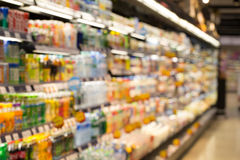 Supermarket. Blur view of beverage product on refrigerator shelves in supermarket Stock Photography