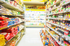Supermarket with blurred bokeh background store. Food and drink business Stock Images