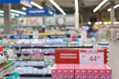 Supermarket in blurry for background. Blurred abstract customer shopping for cookies, candies. Abstract blurred supermarket aisle. With colorful shelves and stock photography