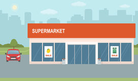 Supermarket building on city background. Royalty Free Stock Photos