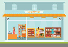 Supermarket building and interior with people buying products. Stock Image