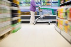 Supermarket buyer with shopping cart Royalty Free Stock Photo