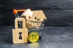 A supermarket cart with houses and bitcoin and a padlock. growth value Bitcoin and the reliability of long-term investments. stock photos
