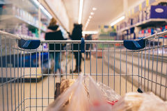 Supermarket cart POV and the blurred background Stock Image