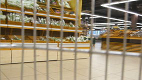 Supermarket cart riding throuth shop. Camera inside trolley going through grocery store. stock footage