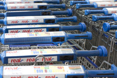 Supermarket carts with Real sign Stock Photo