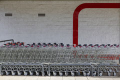 Supermarket carts in a shopping mall. Supermarket carts in a row, in a shopping mall Stock Images