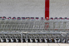 Supermarket carts in a shopping mall. Supermarket carts in a row, in a shopping mall Stock Photo