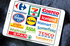 Supermarket chains and retail brands and logos. Collection of logos and brands of world's biggest supermarket chains and retails on white tablet. chains like royalty free stock photos
