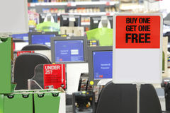Supermarket checkout. Supermarket shop checkout with buy one get one free bogof sign royalty free stock photo