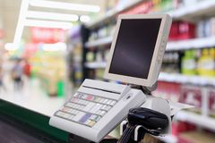 Supermarket checkout cash counter with payment terminal. Supermarket checkout cash desk counter with payment terminal Royalty Free Stock Photography